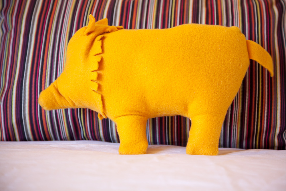 Local artist Karen Sucharski makes the plush javelinas on each bed