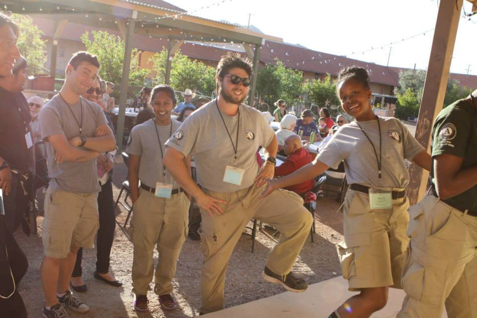 A group of Americorps crew members at a dinner in our courtyard during the 2015 Community Arts Gathering