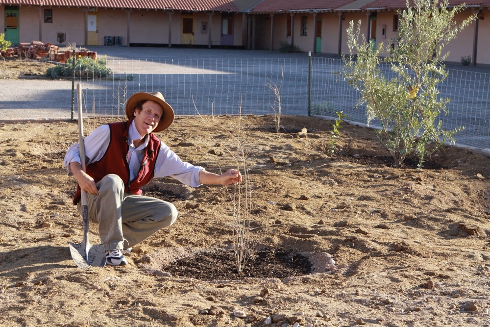 Greg Duggan planting the pomegranate orchard in the Conference Center courtyard in 2011.