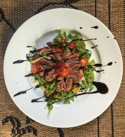 Strawberry Cherry Steak Salad plated and ready to eat.