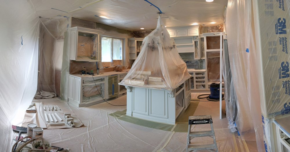Cabinet painting requires a lot of masking and protecting of the home.