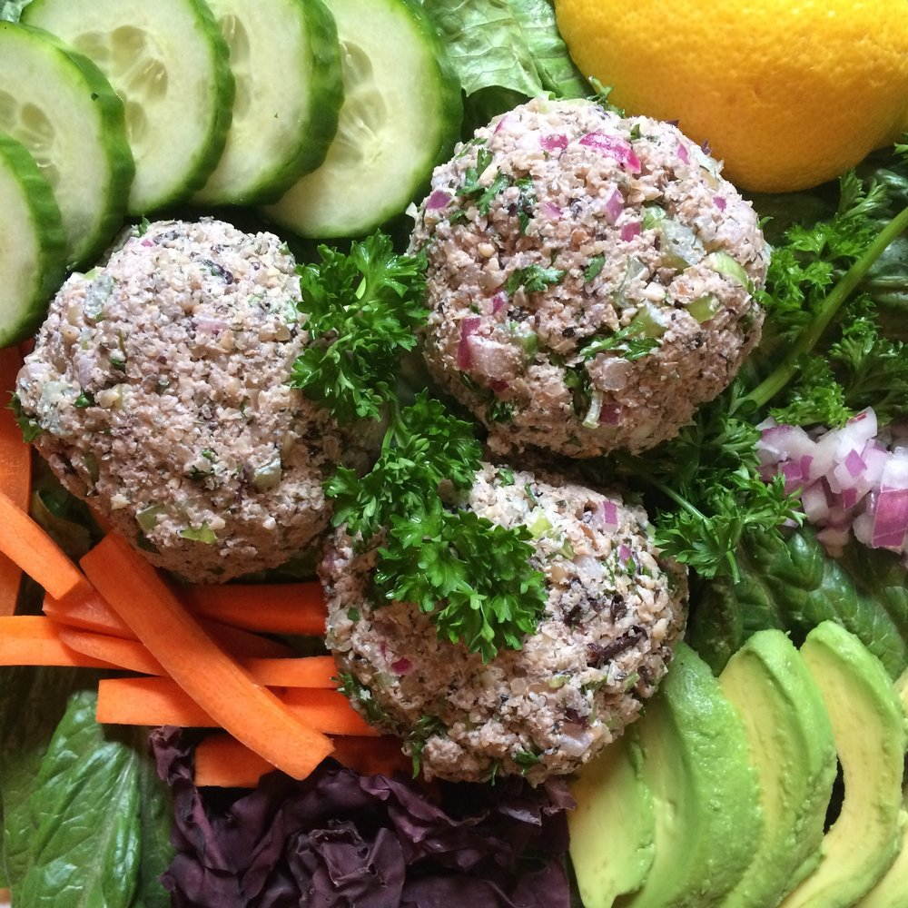 "Not-Tuna Salad      Makes about 2 cups     Looks like Tuna Salad doesn't it? But it's not! Dulse seaweed is the sustainable seafood choice here, with healthy fats from sunflower seeds and walnuts.  1 cup walnuts  1 cup sunflower seeds + 1/2 cup  1 tsp red wine vinegar  1/3 cup minced celery  1/3 cup minced red onion  1/2 cup fresh parsley  1/3 cup lemon juice  1/3 cup whole leaf dulse  3 tbsp freshly chopped dill or 2 tbsp dried  Salt and pepper to taste  Water if needed during processing  Start off by soaking your walnuts and 1 cup of sunflower seeds together in warm water for 30 minutes.  Dice the red onion very small, about 1/4"" and sprinkle the red wine vinegar over the onions in a bowl and set aside.  To prepare the dulse, quickly heat in a cast iron pan for about 1 minutes - do not let it burn! Remove from the heat, let it cool, and crush it into flakes.   Dice the celery the same size as the onion, and roughly chop parsley, dill. and mix together with the onions, lemon juice, dulse flakes, and salt.  Using a food processor, blend the walnuts and soaked sunflower seeds, and dry sunflower seeds together until the oil starts to show on the bowl , and it becomes similar to nut butter, about 2-3 minutes.  Mix together well with wet ingredients and serve in lettuce wraps or on top of a salad with avocado, cucumber, carrot, red onion, and sprouts with your favourite dressing."