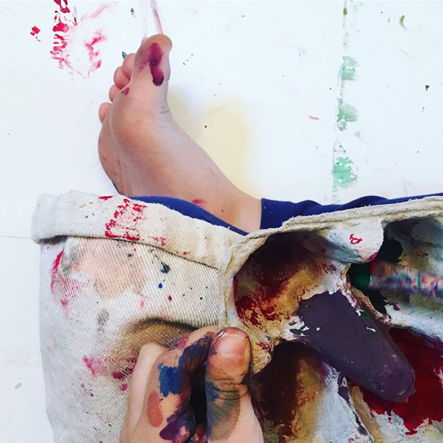 I love this picture so much! Watching little ones drop into their art to the point where even their toes are covered in paint (and their faces) Their enchanted palace was incredible but the journey of getting there was even better. #painteverywhere #processoverproduct #messyhandshappyheart