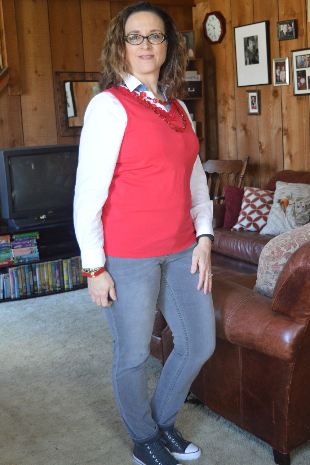 wearing a white long sleeve blouse under a tank top