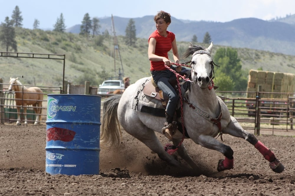 Barrel Horse, Jetting To Success, and rider, Jackie Widmer, turning first barrel at the Wallis Arena Saddle Series.