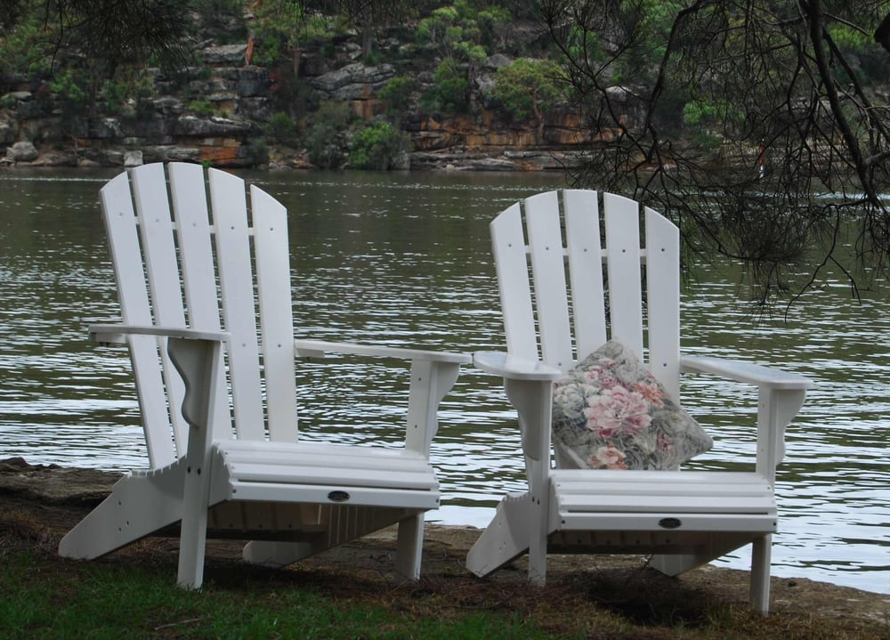 Adirondack chair setting by the river