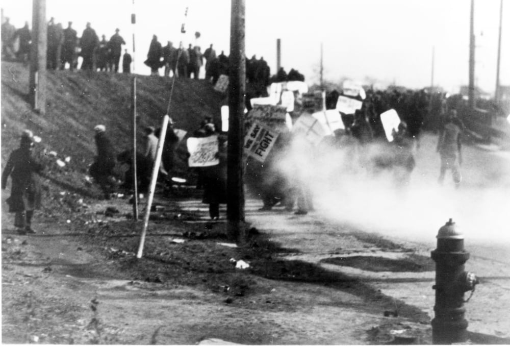 The March 7, 1932, Ford Hunger March was met with clouds of tear gas from Dearborn police. Later, Ford Service Department thugs attacked the marchers, shooting into the crowd. Four marchers were killed that day, with another dying later from injuries, and scores of others were injured. Maurice Sugar led the legal battle on behalf of the marchers. Walter Reuther Library, Wayne State University