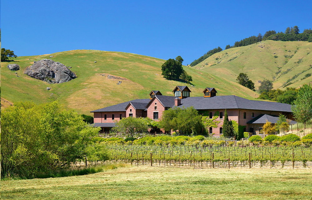 Nestled in rolling foothills.  Spread out like Skywalker ranch