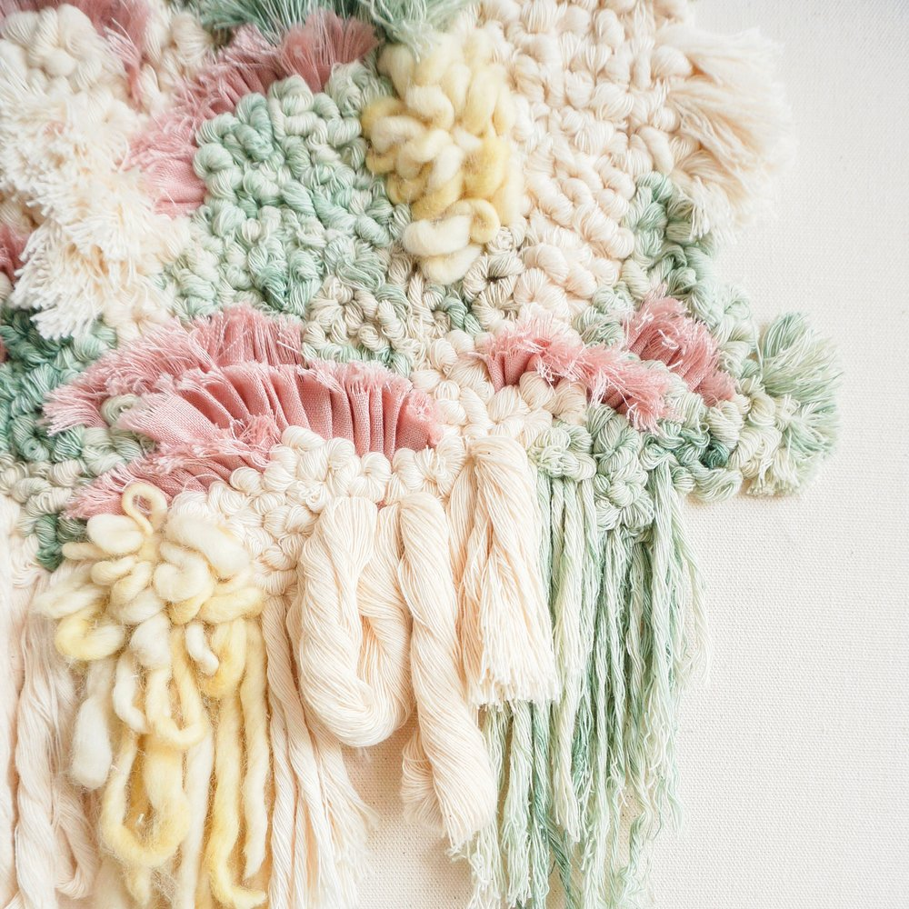 "MARIANA BAERTL of LIVING FIBERS - "" Hi! My name is Mariana Baertl and I'm the creator and artist behind Living Fibers. I was born and raised in Lima, Peru's capital, surrounded by the countries' traditional handmade trades, specially textile work.I studied Fashion Design in Peru and later moved to Buenos Aires, Argentina to focus on Coolhunting, the study of ""trends"" and how it relates specifically to the fashion industry. I then moved to Barcelona, Spain to begin my work in Haute Couture and pattern making. My Haute Couture education taught me the level of patience and precision needed in creating handmade designs. Thereafter I got a post graduate degree in Fashion Business management from Pompeu Fabra University, in Barcelona. As soon as I graduated, I moved back to Lima, Peru to work as a fashion designer for a large retailer in Lima. It was at this company where I started experimenting with textures and textiles. I was soon in love with the art and began making fiber art pieces whenever I could find the time. After several years as a fashion designer, I decided to make a change and immerse myself into the fiber world."""
