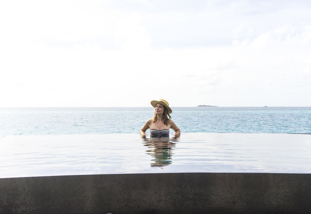 Bathing in one of the water villa's private infinity pool