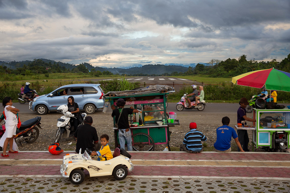 The end of the Nabire's runway is a popular hang out where locals go to enjoy street food and low-tech carnival rides. Though it is an Indonesian construction, Nabire, is centred around the town runway, like the Papuan villages of the interior.