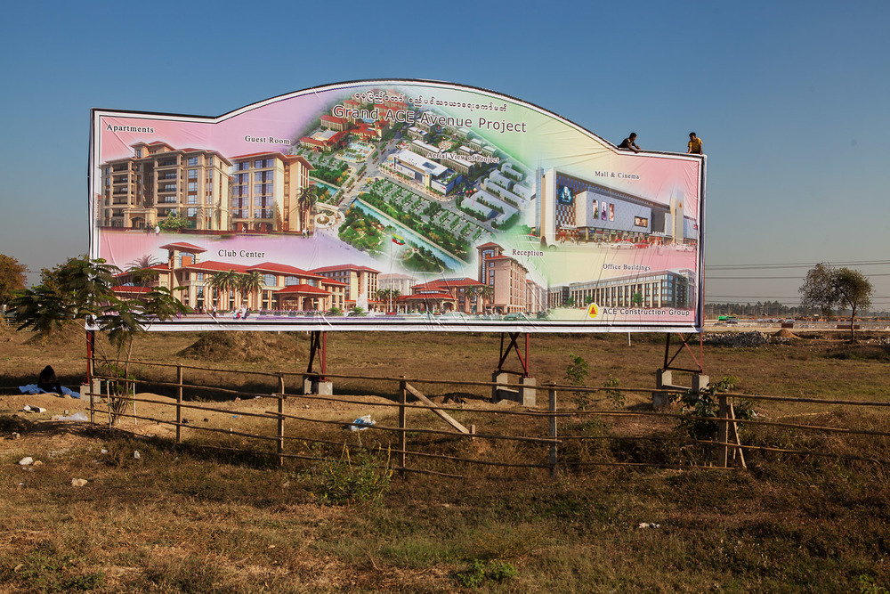A billboard advertises a new property development.