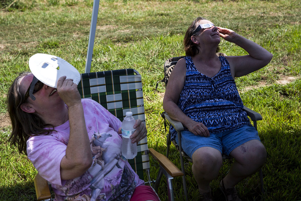 Joann Saratavich, left, from Elkhart, and her sister Rose, from Springfield, watch the solar eclipse at Giant City State Park near Carbondale.