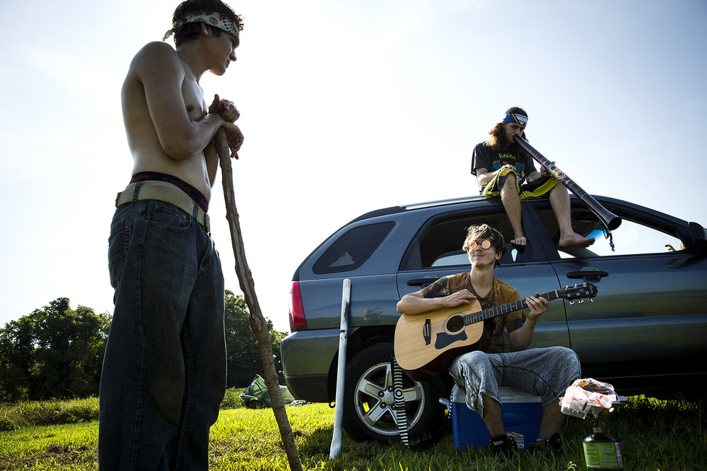 Thomas Kasper, left, Kyle Mohr and his brother Braden, relax while waiting for the solar eclipse in Giant City State Park Monday, Aug. 21, 2017 in Carbondale, Ill. The three and another friend decided spontaneously Sunday afternoon to drive overnight from Merrill, Wis., arriving at 1 a.m.