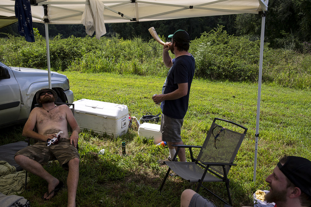 William O'Connor, left, his brother Sean, both from Chicago, and Justin Moll from St. Louis wait for the solar eclipse to begin at Giant City State Park near Carbondale.