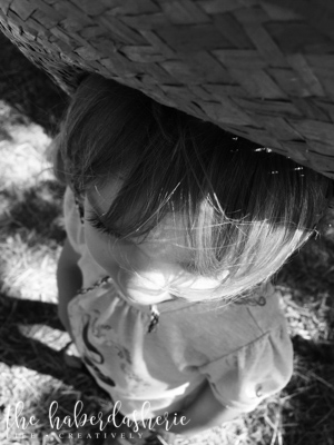 the focus is the child . her hair . her eyelashes .