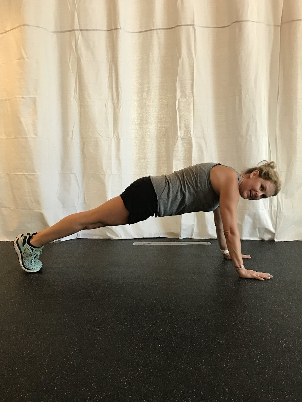 Top of the pushup: strong plank position