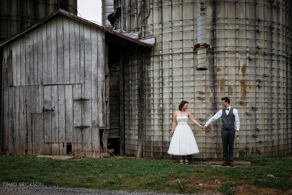 Bride and groom at barn at The Grove