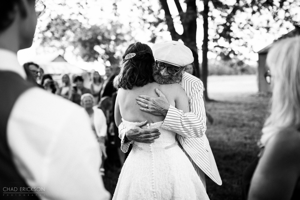 bride and father hugging b&w