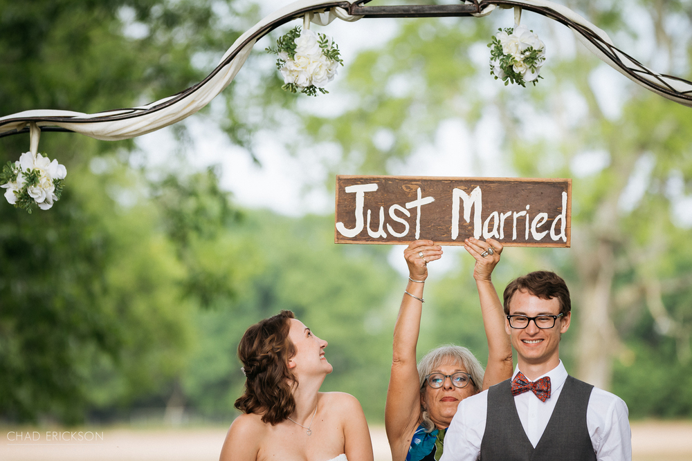 Officiant holding sign