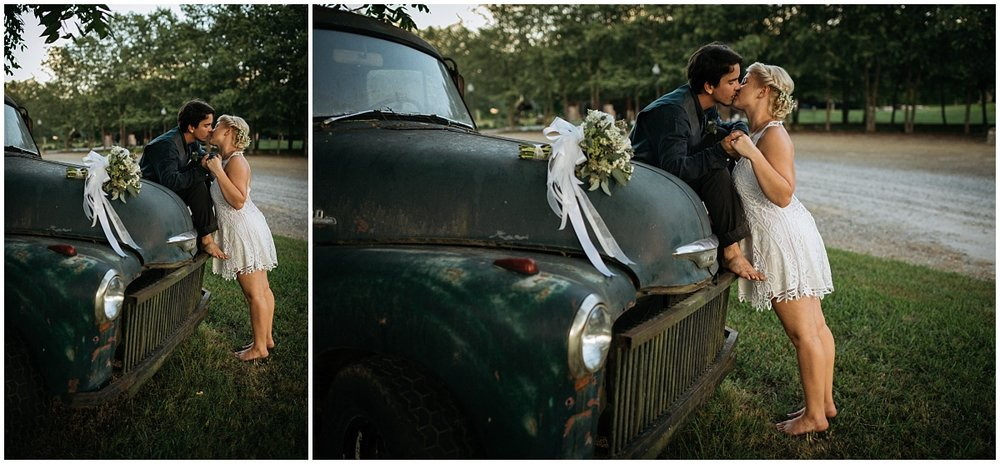 Couple posing on old car