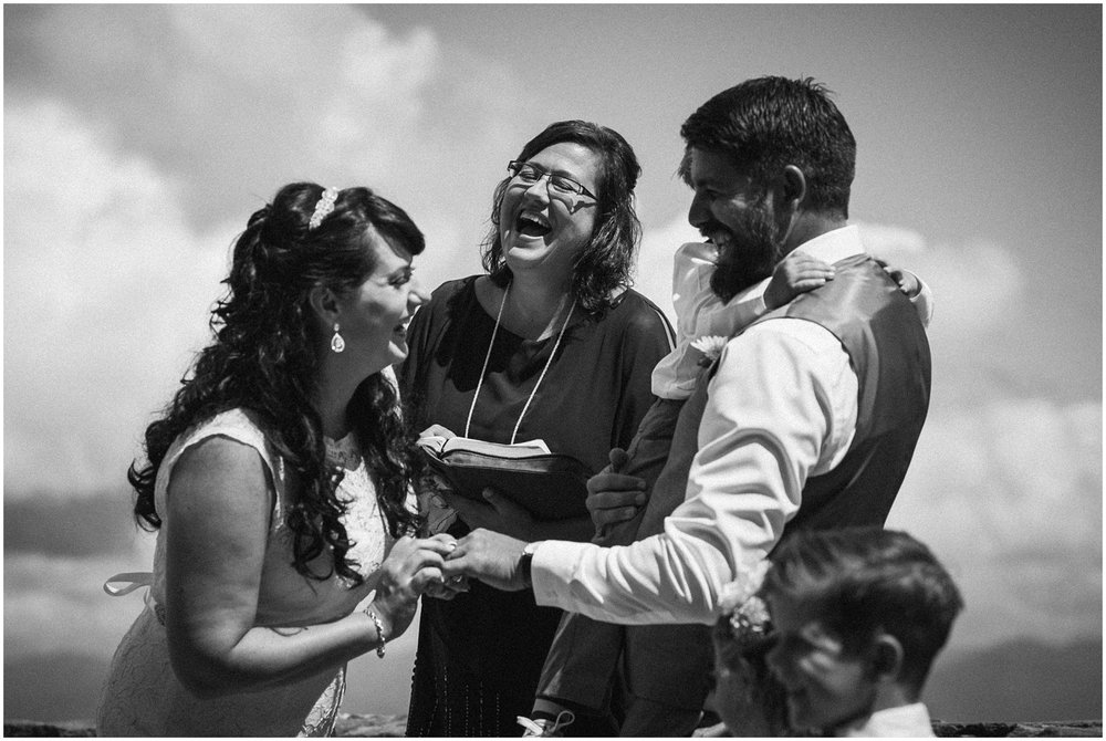 Bride and groom laughing in ceremony