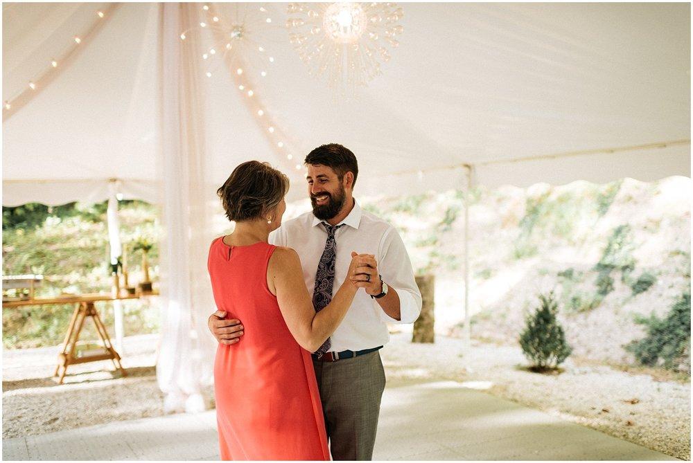 Mother and groom dancing