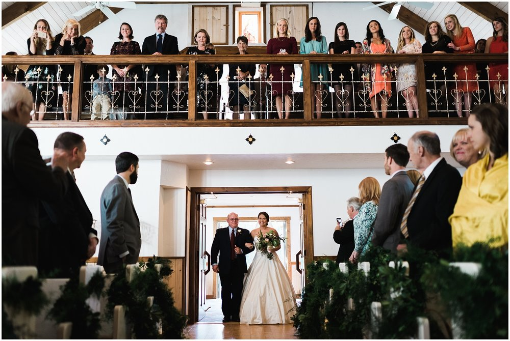 Bride walking down aisle at Chota Falls wedding