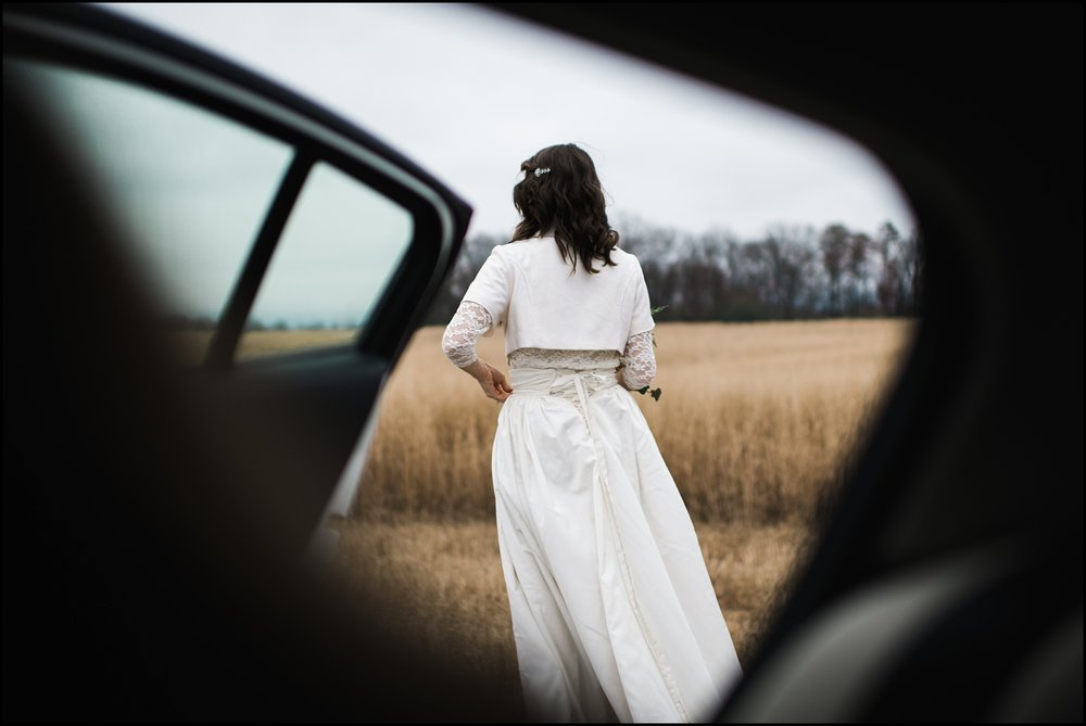 Photojournalist shot of bride getting out of car