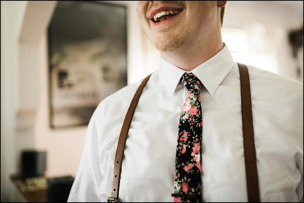 Groom's tie while smiling