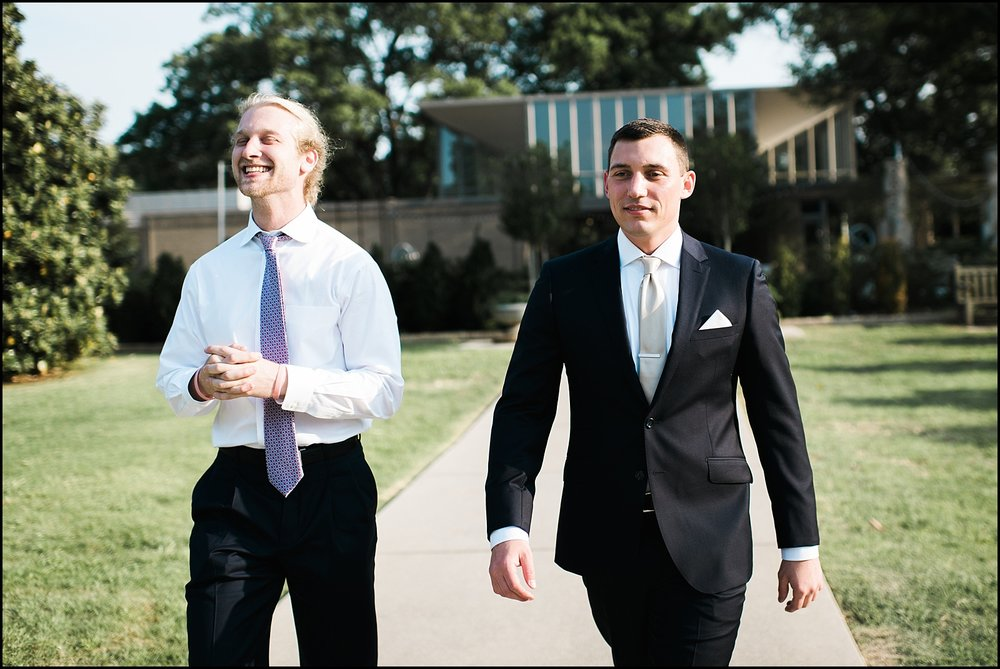 Groom walking with groomsman