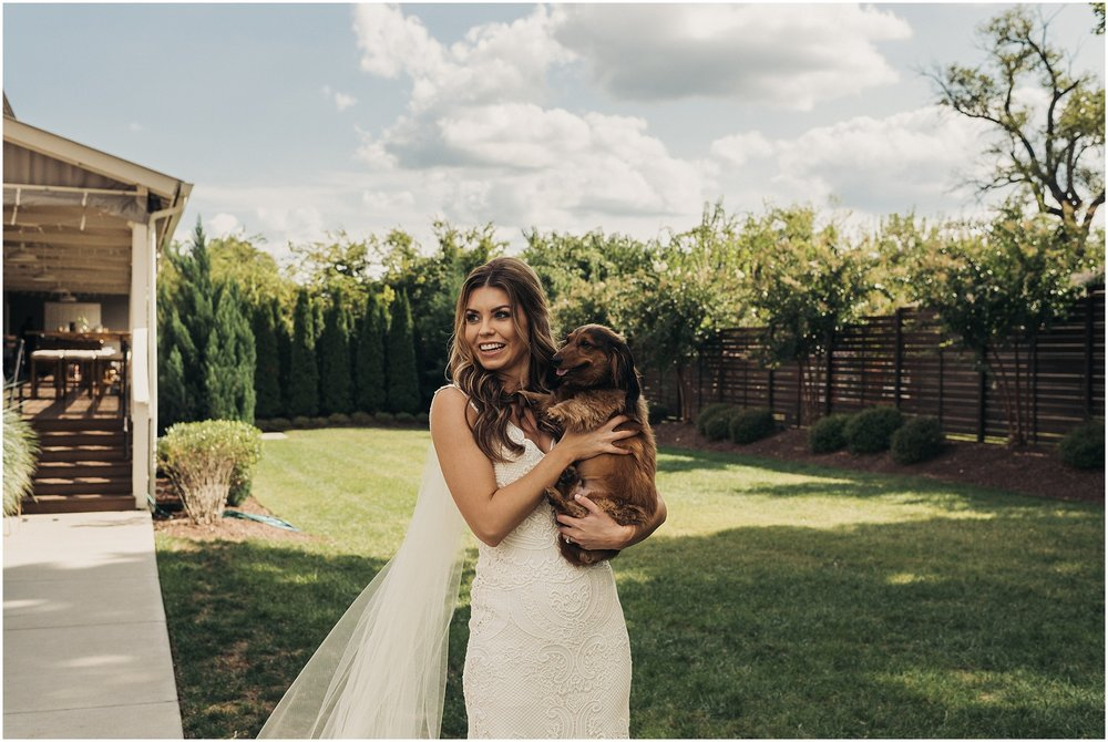 Bride with dog outside The Cordelle