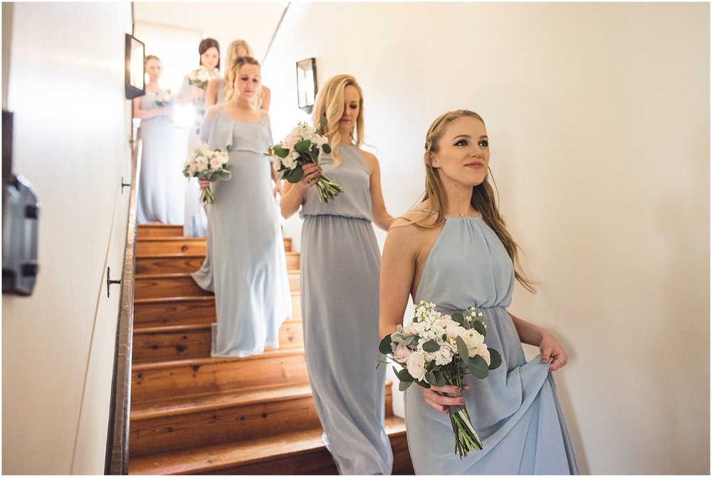 Bridesmaids walking down stairs