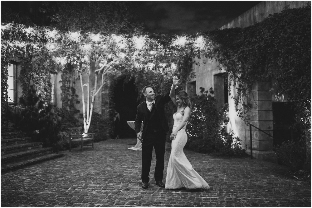 B&W Couple dancing in courtyard