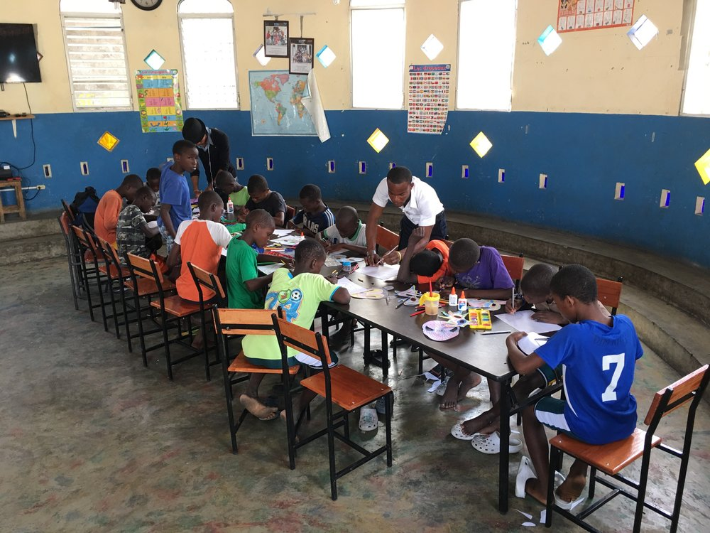 "Class in progress, downtown Port-au-Prince at ""La Fraternite"" Orphanage"