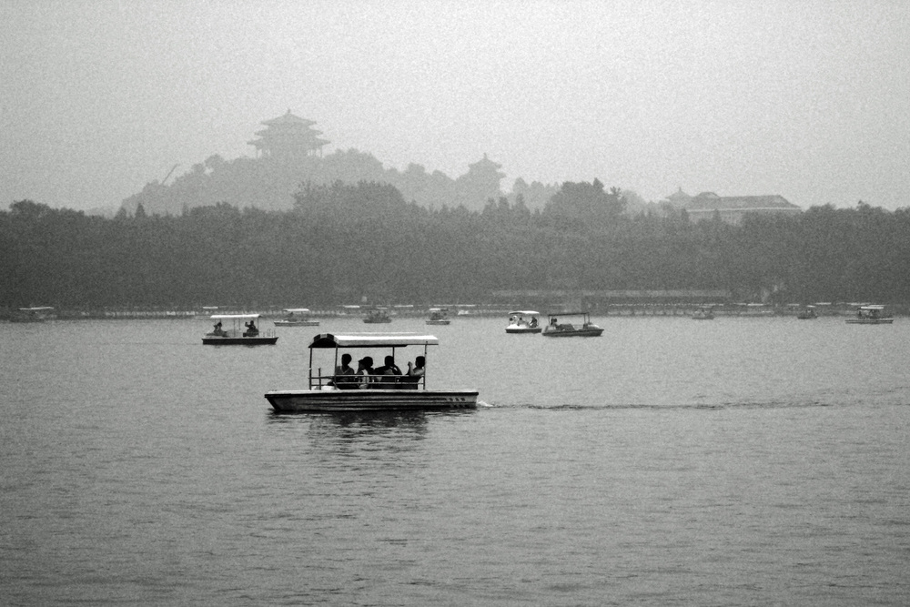 view of the Jingshan park from beihai park in black and white, beijing, china