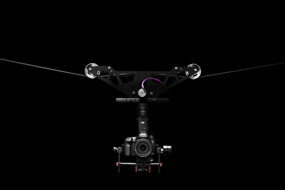Get Customizable Solutions - Our expertise in re-engineering and building customized drones is popular with those who would like a unique event. Create spectacular lighting effects or one to engage with the crowds. For the outdoors, we have an advanced Cable Cam system to enable filming across rough terrains, over crowds in live events, broadcasts, or feature films that need higher capacity payloads.