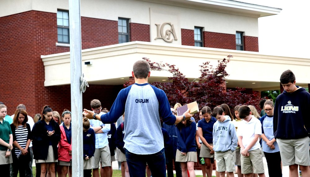 Student Government Chaplain leads Upper School students & faculty in prayer as part of the national See You At the Pole movement.