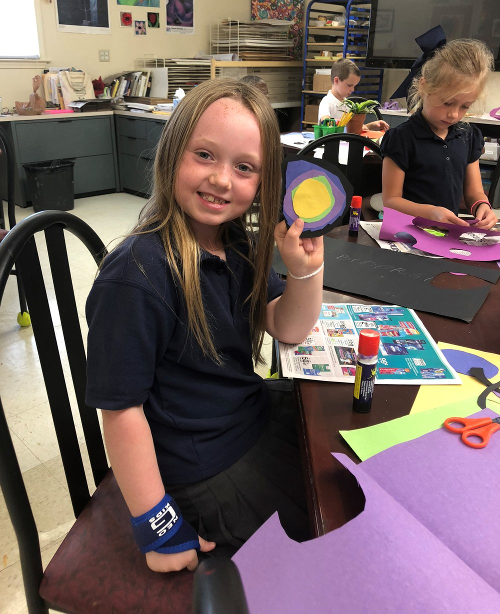 1st grade girl with project.jpg