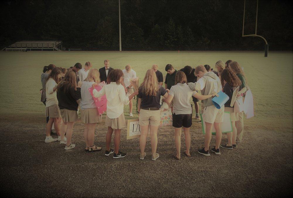 seniors praying.jpg