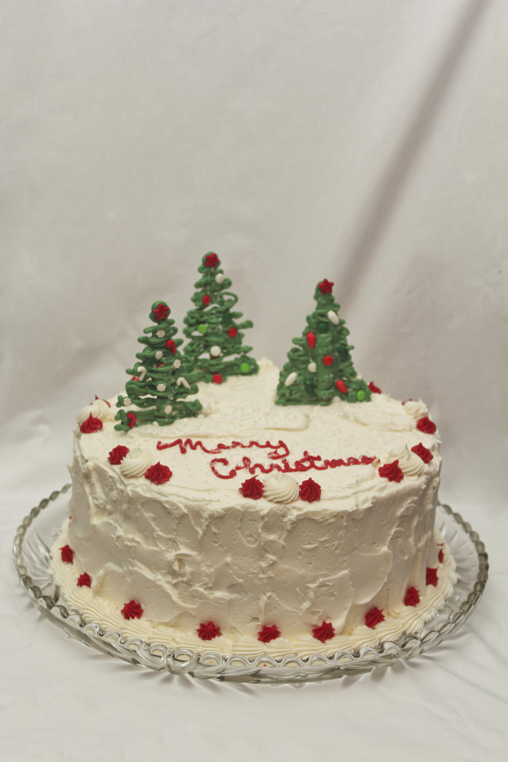 Christmas themed cake decorated with Christmas trees made of chocolate