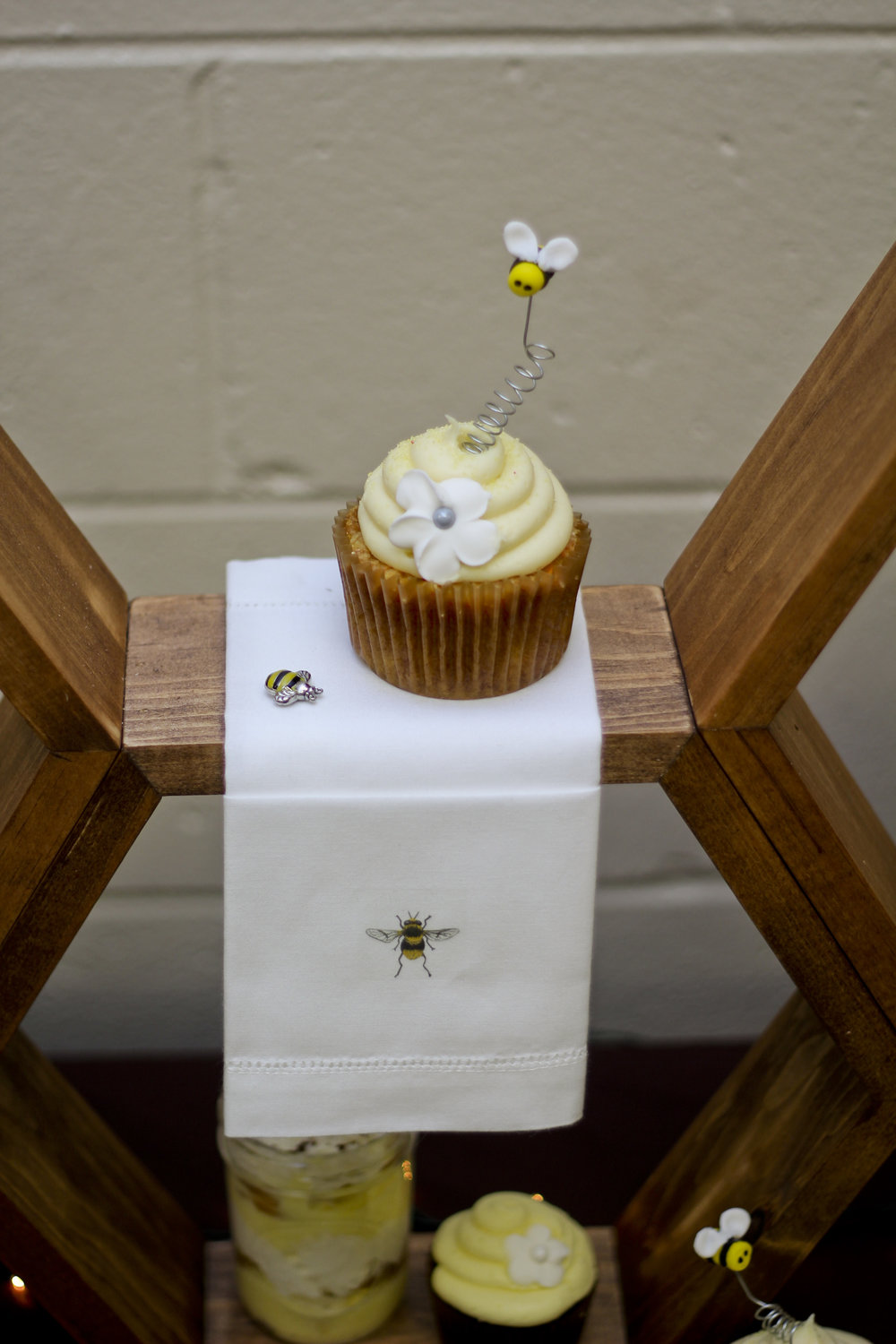 Vanilla cupcake for a pooh bear themed baby shower. Vanilla cake with buttercream icing decorated with succulents and a flower and a fondant bumblebee.