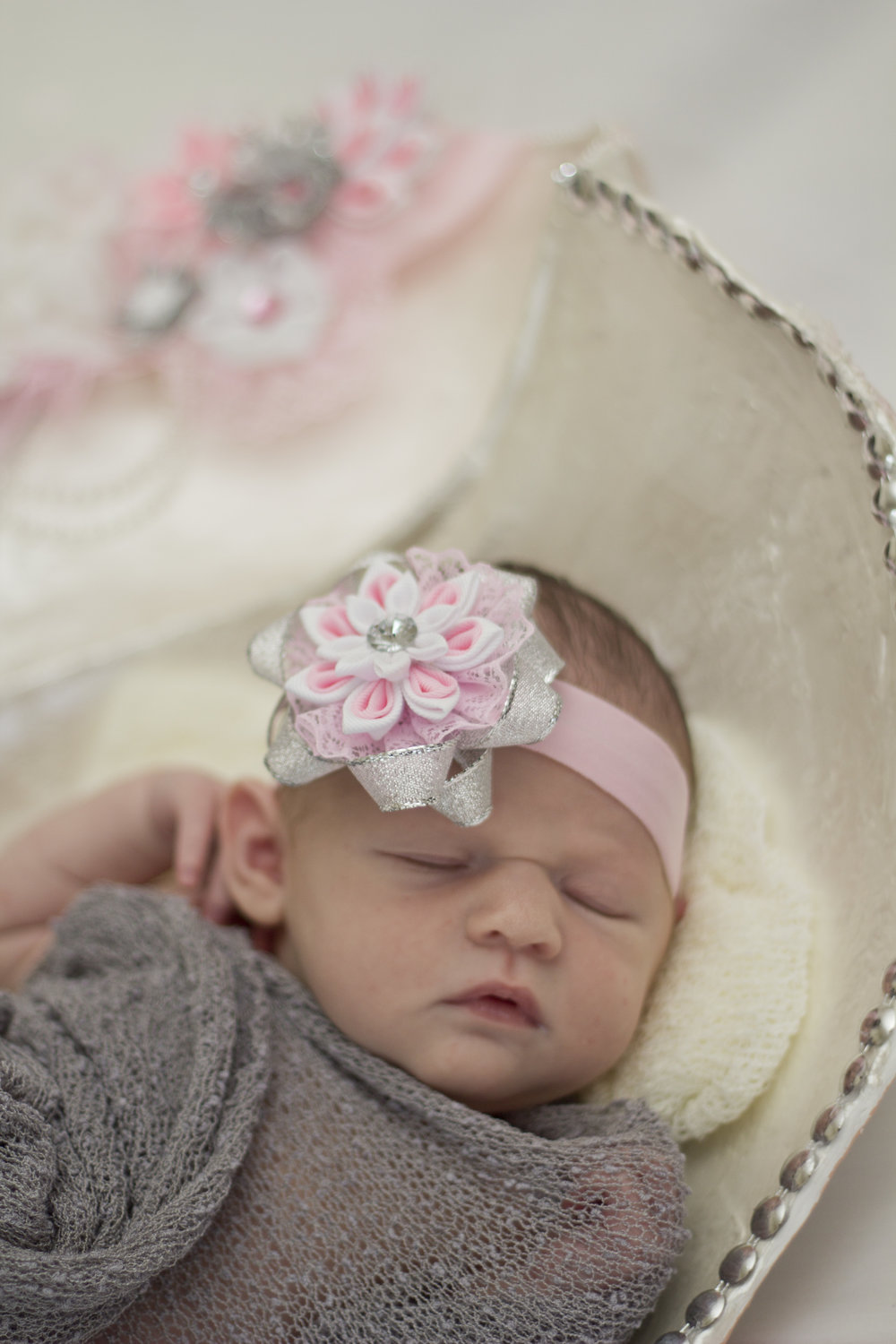 Sweet newborn baby girl session in Southern New Jersey. Look at that adorable headband handmade by her aunt!