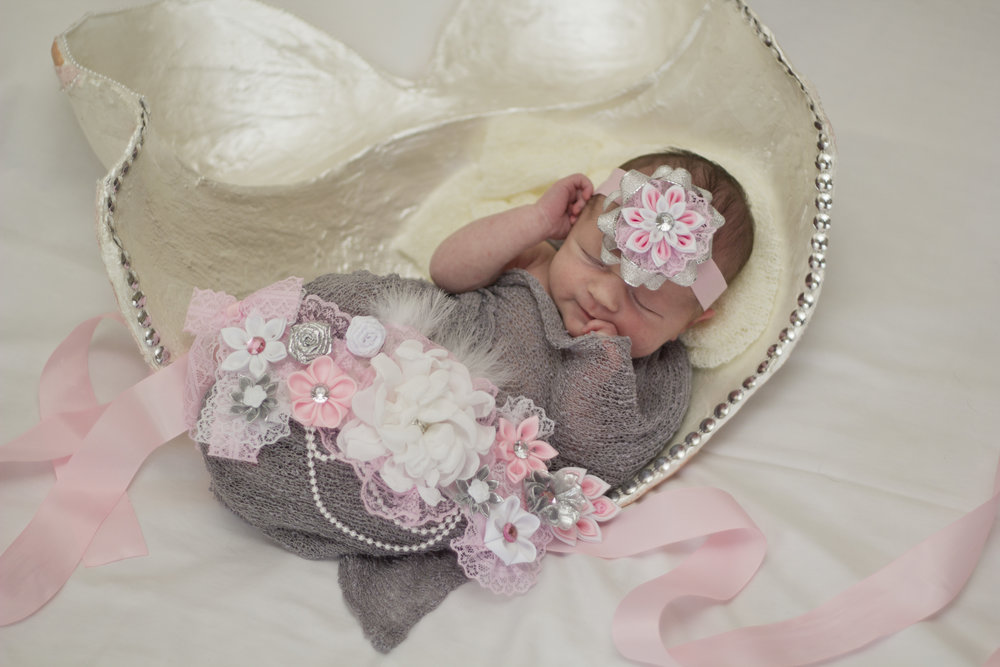 Sweet newborn baby girl session in Southern New Jersey. That maternity sash and headband are so beautiful! I love that her mama wanted newborn pictures in her belly cast.