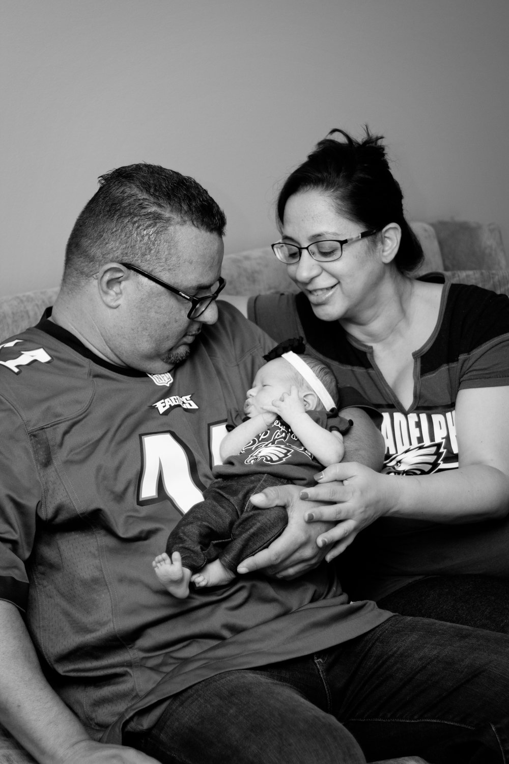 Sweet newborn baby girl session in Southern New Jersey. The sweet family of a newborn baby girl all wearing their Eagles gear. Super Bowl LII Champions!