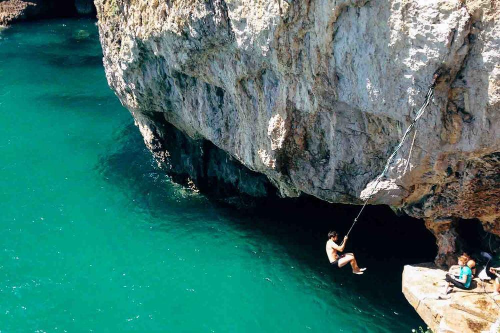 Marco swinging around like Tarzan.