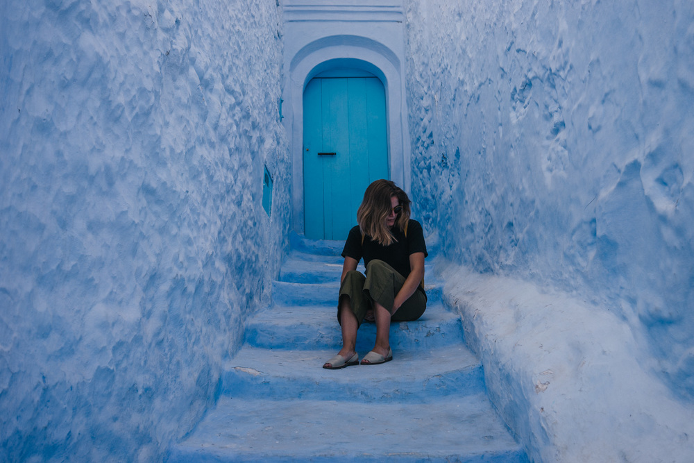 Posing in one of the million tiny corridors of Chefchaouen.