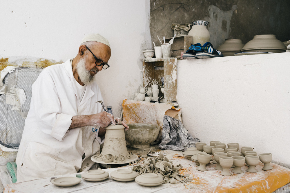 An artisan making pottery at the factory.