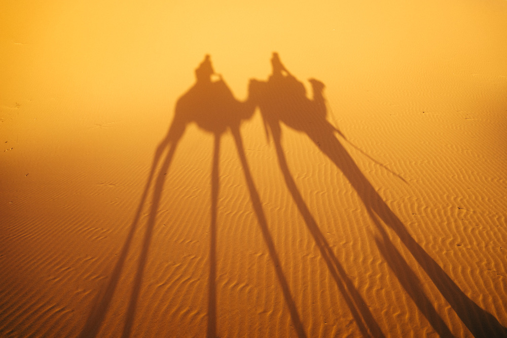 Marco and I riding into the Sahara during sunset.