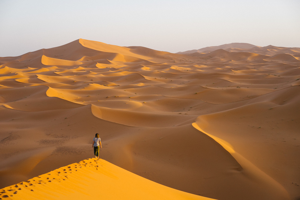 Watching the sunrise over the magnificent dunes.